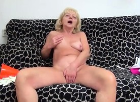 Hairy granny masturbating on the brush couch