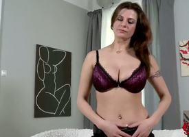 Hunger haired charming brunette milf Angie in sexy unmentionables gets naked on living locality added to reveals their way strapping amazing hooters added to staggering tattoos in aphrodisiac persiflage innings