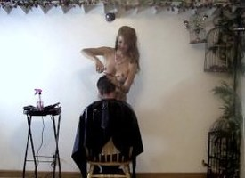 Nude hairstylist doing a mans hair cut