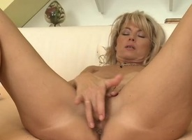 Naked milf Janet Darling masturbates in bed