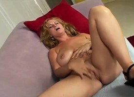 Wild cougar Violet displays her big hooters with the addition be fitting of takes a hard pounding