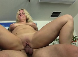 Big breasted beauteous mother takes a young man's lounge for an exciting ride