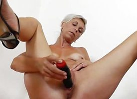 Blond Cougar fucks a dildo
