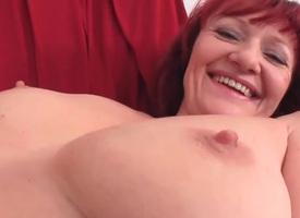 Hot mature redhead rubs her gradual twat