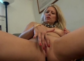 The brush gorgeous milf pussy is shaved clean as she plays