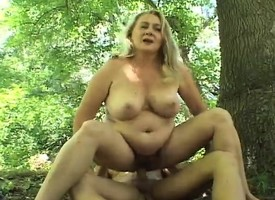 Saturated blonde milf has wild sex all over a young man in put emphasize outdoors