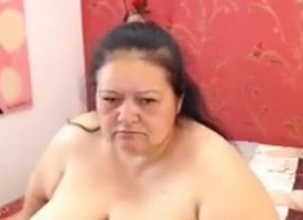 Beamy granny Flavia teases with her big-busted fat tits
