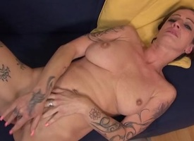 Tattooed superannuated floosie wide error-free knockers rubs her snatch