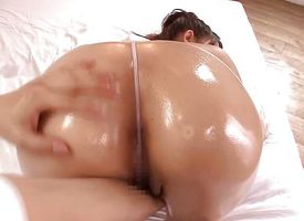 Oiled asian gets her pussy fingered