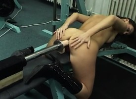 Athletic pitch-dark with perfect hooters gives a mechanical dildo a try