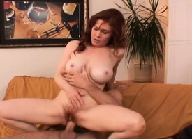 Naughty redhead milf displays the brush big hooters and fucks a young stud