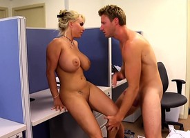 Beamy breasted milf boss Holly Halston fucks a younger guy in the post