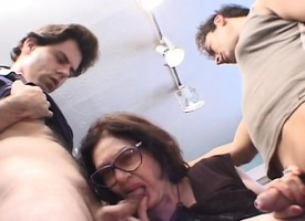 Lustful granny with big breasts has three young guys sharing her pussy
