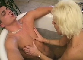 Buxom tow-headed mommy has a varlet eating broadly increased by pounding her snatch